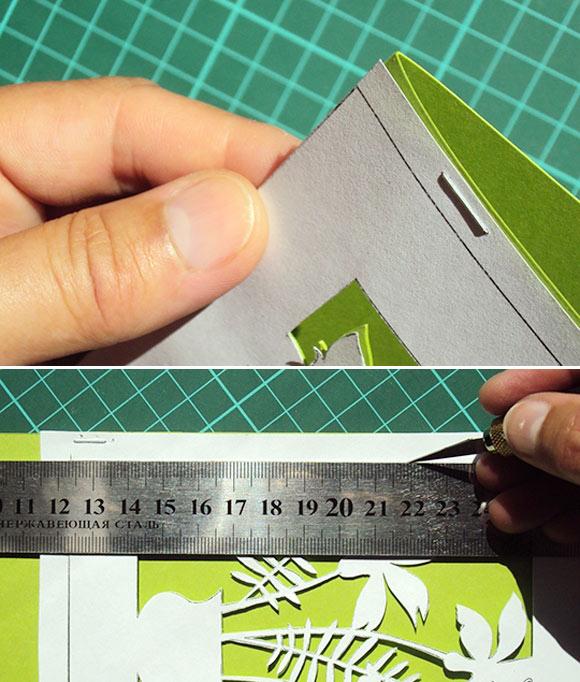 Dùng thước và dao trổ để căt viền cho hình nền